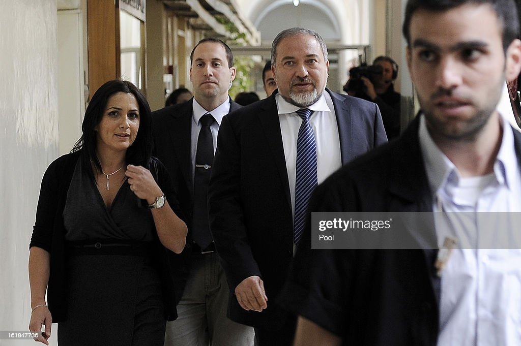 Israel's former Foreign Minister <a gi-track='captionPersonalityLinkClicked' href=/galleries/search?phrase=Avigdor+Lieberman&family=editorial&specificpeople=652650 ng-click='$event.stopPropagation()'>Avigdor Lieberman</a> (2nd R) arrives for the opening hearing of his trial in which is he is facing charges of fraud and breach of trust, at Jerusalem Magistrates Court on February 17, 2013 in Jerusalem, Israel. Concerning incidents which took place more than a decade ago, Lieberman is accused of trying to advance the career of a former diplomat who relayed information to him about a since closed criminal investigation into his business dealings. Lieberman pleaded not guilty on all counts, expressing confidence that he will be cleared of all charges so that he may resume his role as Foreign Minister.