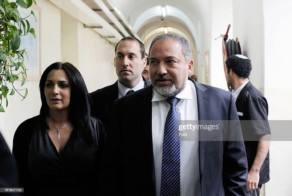 Israel's former Foreign Minister <a gi-track='captionPersonalityLinkClicked' href=/galleries/search?phrase=Avigdor+Lieberman&family=editorial&specificpeople=652650 ng-click='$event.stopPropagation()'>Avigdor Lieberman</a> (R) arrives for the opening hearing of his trial in which is he is facing charges of fraud and breach of trust, at Jerusalem Magistrates Court on February 17, 2013 in Jerusalem, Israel. Concerning incidents which took place more than a decade ago, Lieberman is accused of trying to advance the career of a former diplomat who relayed information to him about a since closed criminal investigation into his business dealings. Lieberman pleaded not guilty on all counts, expressing confidence that he will be cleared of all charges so that he may resume his role as Foreign Minister.