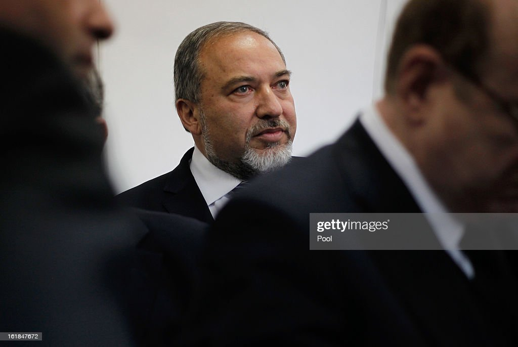 Israel's former Foreign Minister <a gi-track='captionPersonalityLinkClicked' href=/galleries/search?phrase=Avigdor+Lieberman&family=editorial&specificpeople=652650 ng-click='$event.stopPropagation()'>Avigdor Lieberman</a> attends the opening hearing of his trial in which is he is facing charges of fraud and breach of trust, at Jerusalem Magistrates Court on February 17, 2013 in Jerusalem, Israel. Concerning incidents which took place more than a decade ago, Lieberman is accused of trying to advance the career of a former diplomat who relayed information to him about a since closed criminal investigation into his business dealings. Lieberman pleaded not guilty on all counts, expressing confidence that he will be cleared of all charges so that he may resume his role as Foreign Minister.