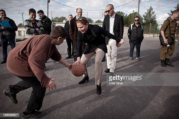 Israel's former foreign minister Tzipi Livni now head of the new political party 'The Movement' plays basketball during a campaign tour on December...
