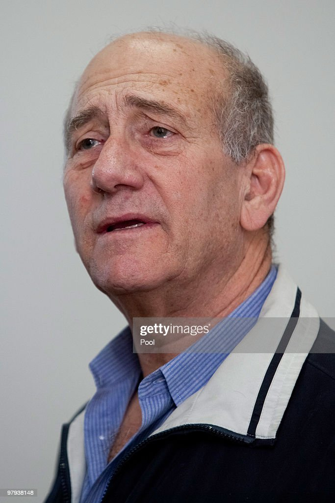 Israel's former Prime Minister <a gi-track='captionPersonalityLinkClicked' href=/galleries/search?phrase=Ehud+Olmert&family=editorial&specificpeople=178946 ng-click='$event.stopPropagation()'>Ehud Olmert</a> waits in the courtroom during his trial at the District Court on March 22, 2010 in Jerusalem, Israel. Olmert is being charged with illegally accepting funds from an American supporter and double-billing Jewish groups for trips abroad.