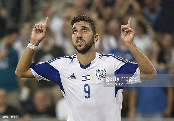 Israel's forward Munas Dabbur reacts after scoring a goal against Andorra during their Euro 2016 qualifying football match at the Sammy Ofer Stadium...