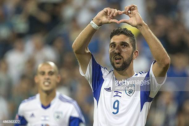 Israel's forward Munas Dabbur reacts following scoring a goal against Andorra's defender Ildefons Lima during their Euro 2016 qualifying football...