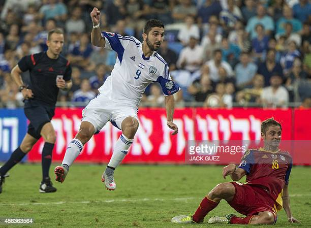 Israel's forward Munas Dabbur scores a goal as Andorra's defender Ildefons Lima watches on during their Euro 2016 qualifying football match against...