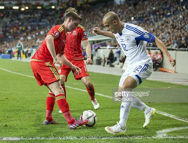 Israel's forward Tal Ben Haim fights for the ball with Wales' midfielders Joe Allen and Aaron Ramsey during the Euro 2016 qualifying football match...