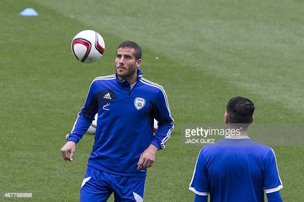 Israels forward Tomer Hemed takes part in a training session at the Sammy Ofer Stadium in the Israeli coastal city of Haifa on March 27 on the eve of...