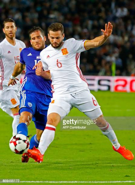 Israel's forward Tomer Hemed vies for the ball with Spain's defender Nacho Fernandez during the Russia 2018 FIFA World Cup European Group G...