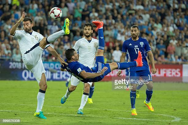Israel's forward Tomer Hemed vies with Italy's defender Andrea Barzagli during the World Cup 2018 qualifier football match Israel vs Italy at Sammy...