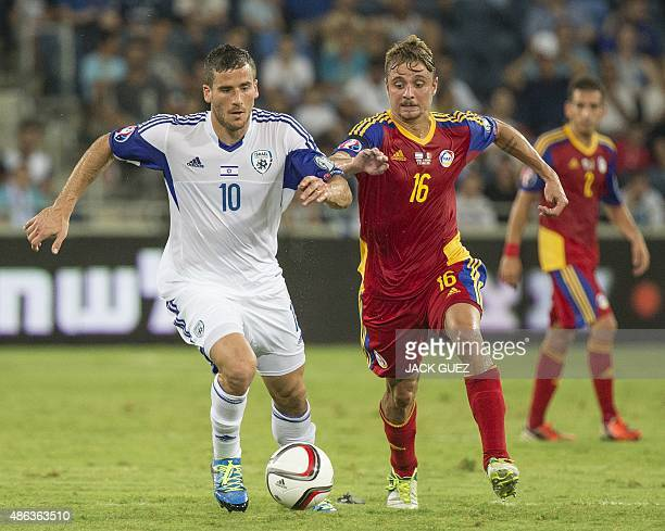 Israel's forward Tomer Hemmed vies for the ball with Andorra's midfielder Marc Rebes during their Euro 2016 qualifying football match at the Sammy...