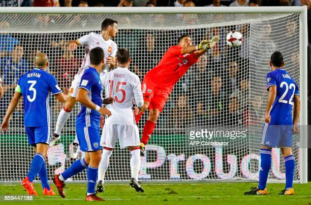 Israel's goalkeeper Ariel Harosh vies for the ball with Spain's forward Artiz Aduriz during the Russia 2018 FIFA World Cup European Group G...
