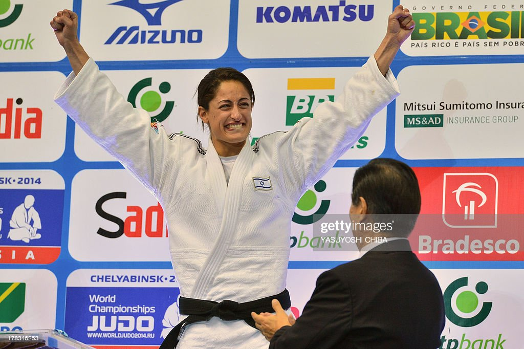 Israel's gold medallist Yarden Gerbi celebrates on the podium during the medal ceremony for the women's -63kg category, during the IJF World Judo Championship, in Rio de Janeiro, Brazil, on August 29, 2013.