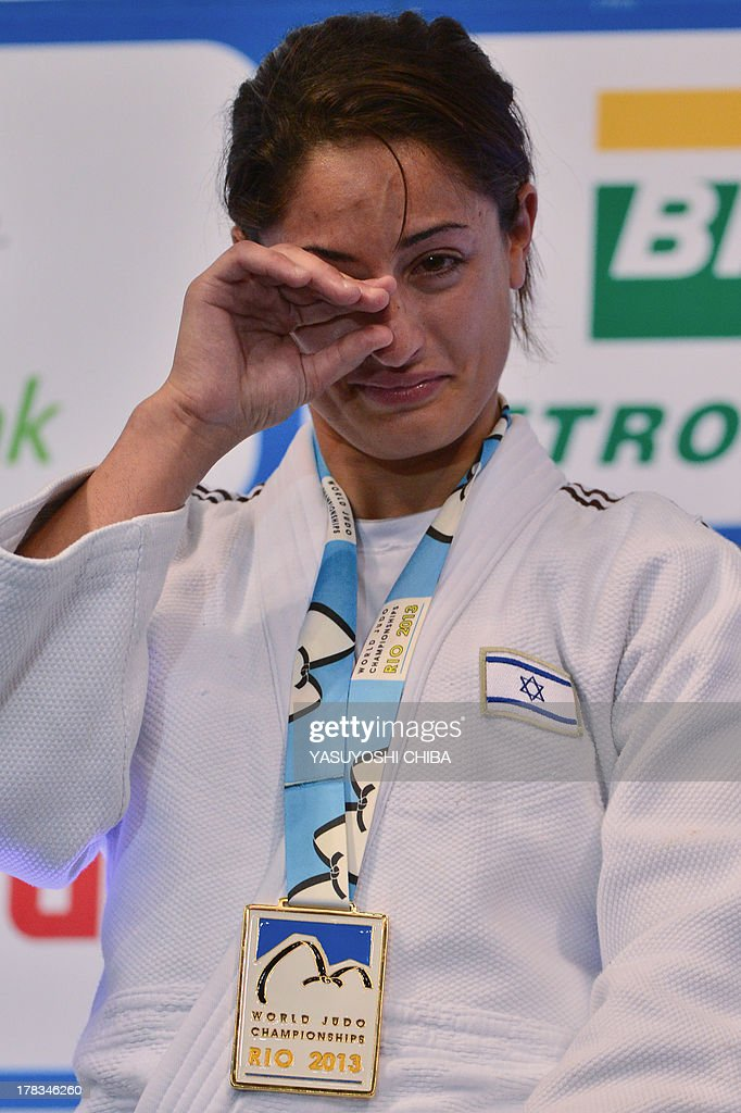 Israel's gold medallist Yarden Gerbi cries on the podium during the medal ceremony for the women's -63kg category, during the IJF World Judo Championship, in Rio de Janeiro, Brazil, on August 29, 2013. AFP PHOTO / YASUYOSHI CHIBA