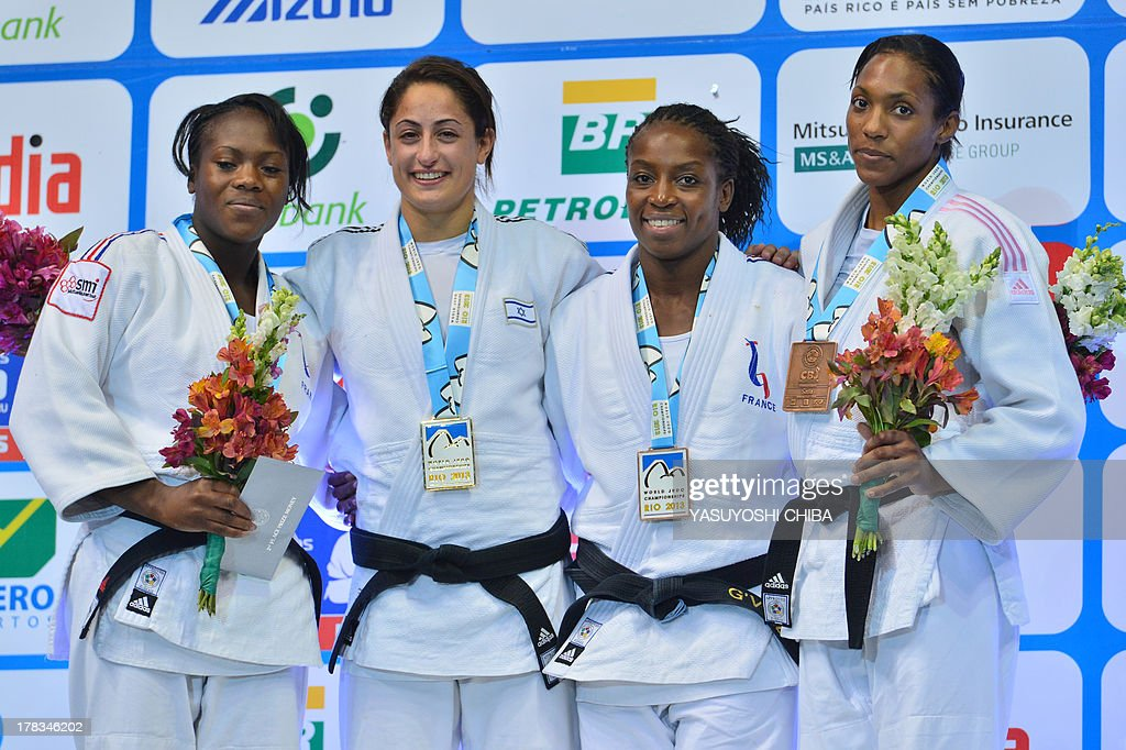 Israel's gold medallist Yarden Gerbi (2-L), France's silver medallist Clarisse Agbegnenou (L), and bronze medallists Anicka Van Emden (R) from the Netherlands and French Gevrise Emane pose on the podium during the medal ceremony for the women's -63kg category, during the IJF World Judo Championship, in Rio de Janeiro, Brazil, on August 29, 2013.