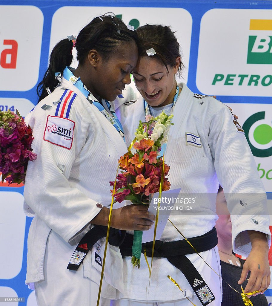 Israel's gold medallist Yarden Gerbi (R) greets France's silver medallist Clarisse Agbegnenou on the podium during the medal ceremony for the women's -63kg category, during the IJF World Judo Championship, in Rio de Janeiro, Brazil, on August 29, 2013.