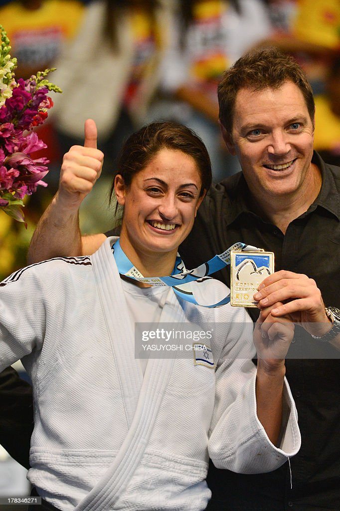Israel's gold medallist Yarden Gerbi (L) poses with her coach on the podium during the medal ceremony for the women's -63kg category, during the IJF World Judo Championship, in Rio de Janeiro, Brazil, on August 29, 2013.