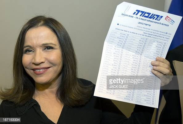 Israel's Labour party leader Shelly Yachimovich holds a ballot before casting her vote during her party's central primary convention at a polling...