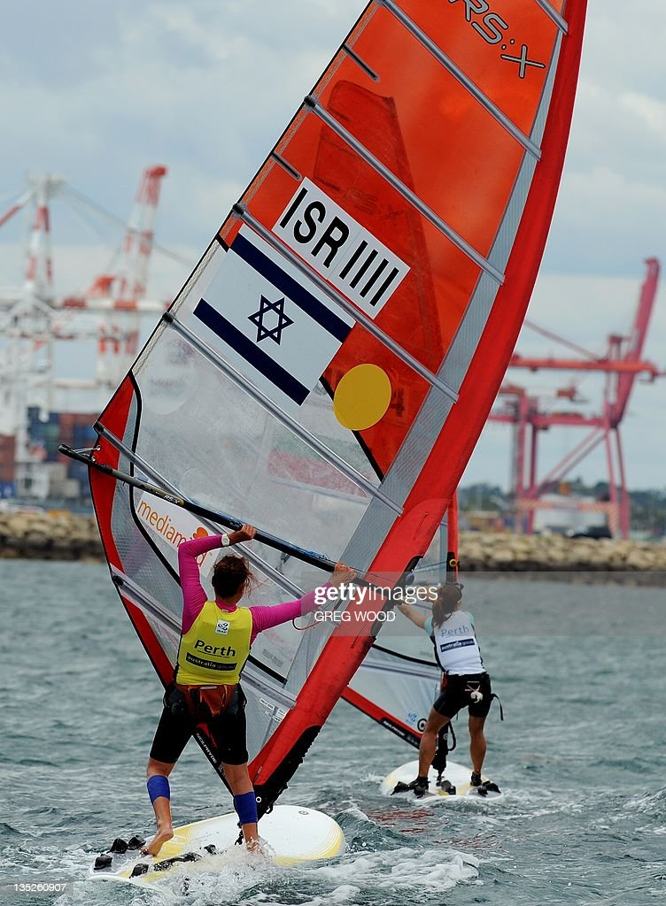 Israel's Lee Korzits (L) rounds a mark in the first Gold Fleet race in the