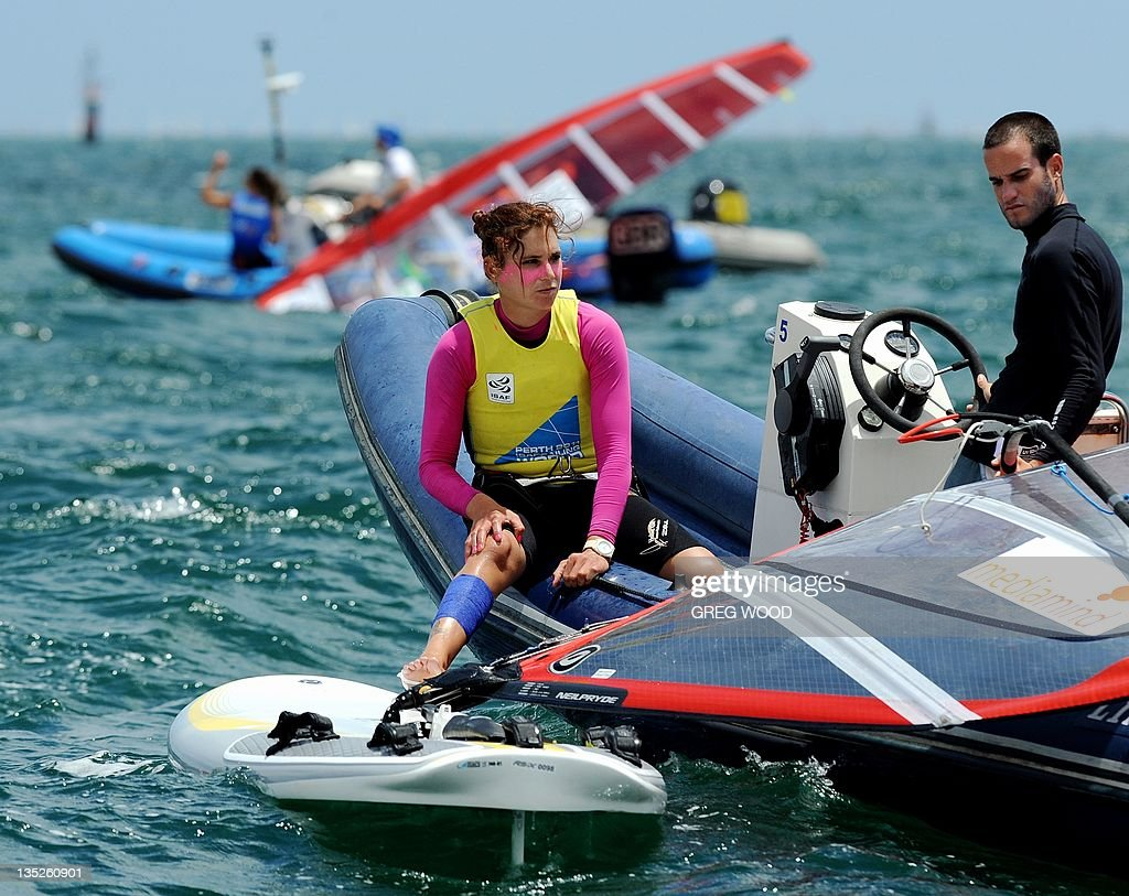 Israel's Lee Korzits (C) waits for a start to be called in the first Gold Fleet race in the