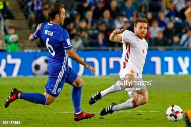 Israel's midfielder Bibras Natcho vies for the ball with Spain's midfielder Asier Illarramendi during the Russia 2018 FIFA World Cup European Group G...