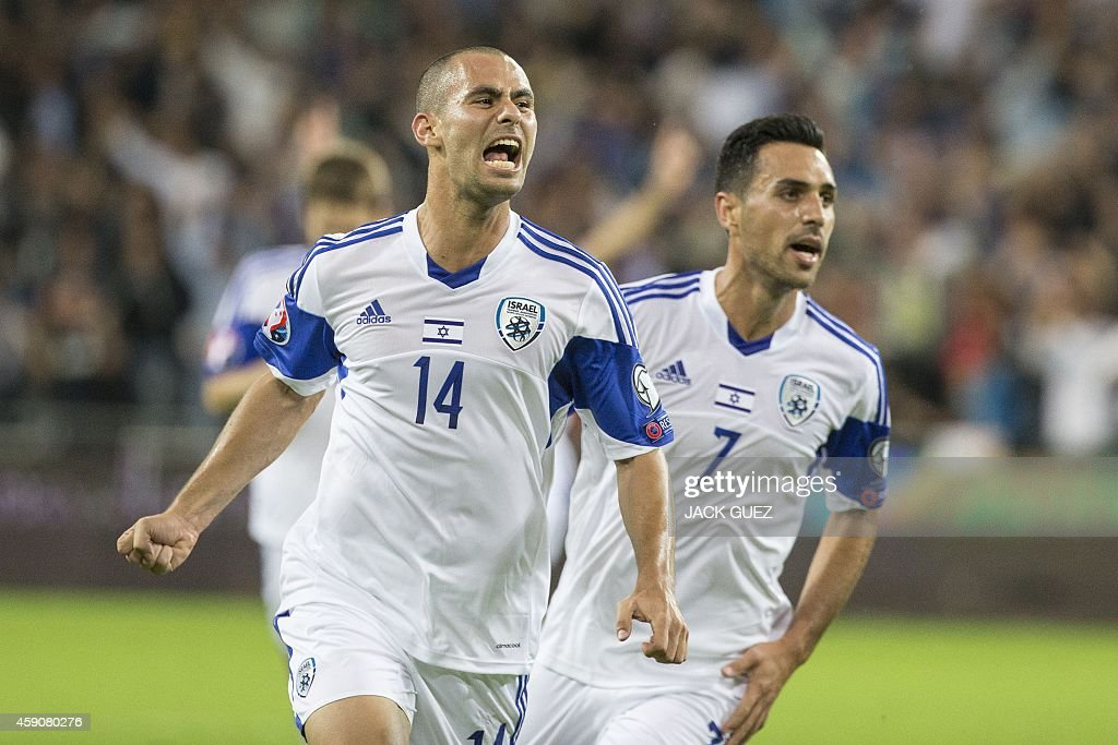 Israel's midfielder Gil Vermouth celebrates after scoreing against BosniaHerzegovina during their Euro 2016 Group B qualifying match at the Sammy...