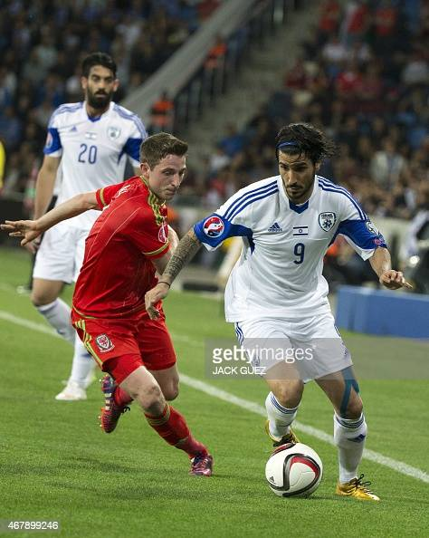 Israel's midfielder Lior Refaelov dribbles past Wales' midfielder Joe Allen during the Euro 2016 qualifying football match between Israel and Wales...
