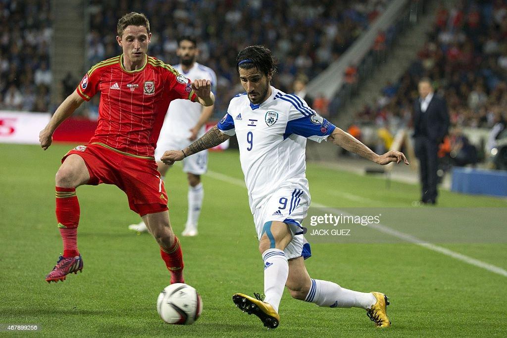 Israel's midfielder Lior Refaelov is defended by Wales' midfielder Joe Allen during the Euro 2016 qualifying football match between Israel and Wales...