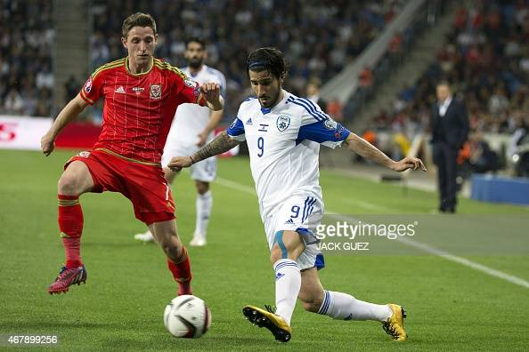 Israel's midfielder Lior Refaelov is defended by Wales' midfielder Joe Allen during the Euro 2016 qualifying football match between Israel and Wales...