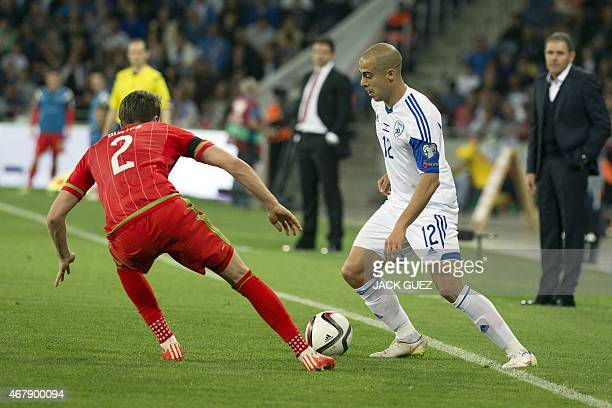 Israel's midfielder Tal Ben Haim is defended by Wales' defender Chris Gunter during the Euro 2016 qualifying football match between Israel and Wales...