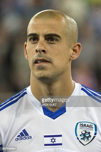 Israel's midfielder Tal Ben Haim stands on the pitch before the Euro 2016 qualifying football match between Israel and Wales at the Sammy Ofer...