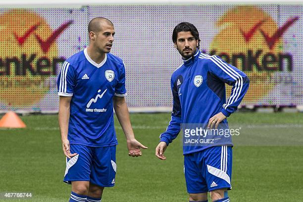 Israels midfielders Lior Refaelov and Tal Ben Haim take part in a training session at the Sammy Ofer Stadium in the Israeli coastal city of Haifa on...