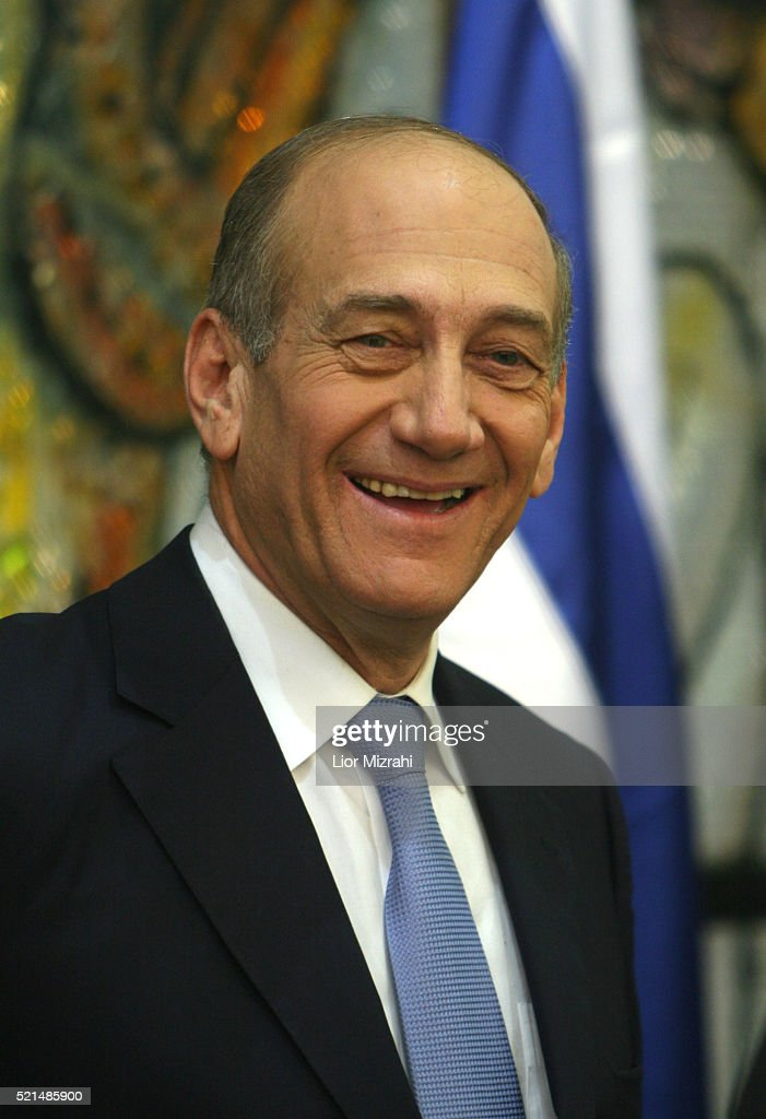 Israel's new Prime Minister <a gi-track='captionPersonalityLinkClicked' href=/galleries/search?phrase=Ehud+Olmert&family=editorial&specificpeople=178946 ng-click='$event.stopPropagation()'>Ehud Olmert</a> smiles before a group photo with his 25 member new cabinet in the Presidential residence in Jerusalem Thursday May 04, 2006. Israeli lawmakers today approved Prime Minister <a gi-track='captionPersonalityLinkClicked' href=/galleries/search?phrase=Ehud+Olmert&family=editorial&specificpeople=178946 ng-click='$event.stopPropagation()'>Ehud Olmert</a>'s new coalition, swearing in a government determined to separate from the Palestinians and rewrite the map of the Middle East. The vote of confidence in Olmert's four-party coalition and 25-member cabinet followed four weeks of intense coalition talks led by his centrist Kadima party, which won a March 28 election and now dominates the government.