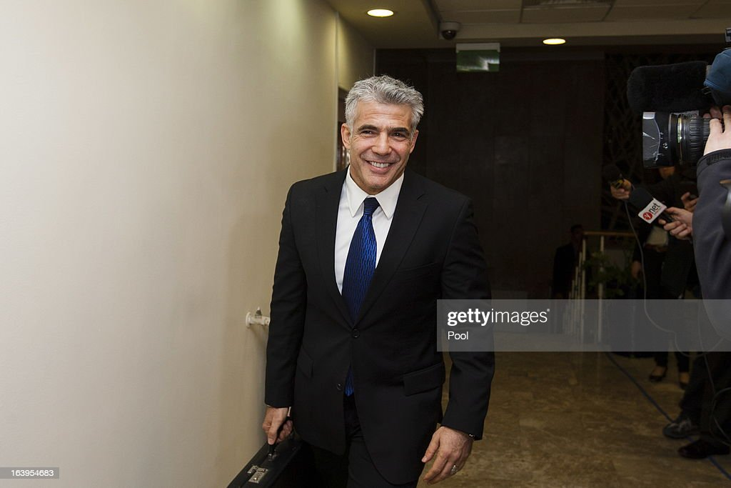 Israel's newly sworn Finance Minister and leader of the Yesh Atid party <a gi-track='captionPersonalityLinkClicked' href=/galleries/search?phrase=Yair+Lapid&family=editorial&specificpeople=5366792 ng-click='$event.stopPropagation()'>Yair Lapid</a> arrives for the first Cabinet meeting after the swearing in of the new Israeli government, at the Prime Minister's Office on March 18, 2013 in Jerusalem, Israel. Israel's 33rd government is to be sworn in today after almost six weeks of negotiations to piece together a coalition government.