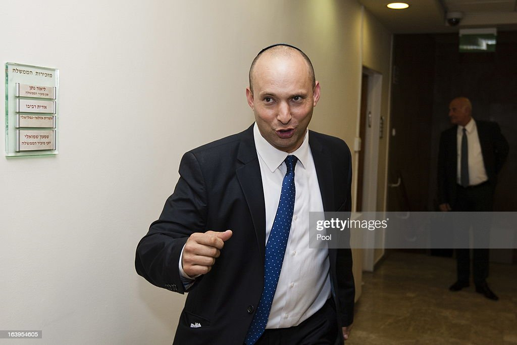 Israel's newly sworn-in Minister of Industry, Trade and Labor and head of Israel's Jewish Home party, <a gi-track='captionPersonalityLinkClicked' href=/galleries/search?phrase=Naftali+Bennett&family=editorial&specificpeople=6632880 ng-click='$event.stopPropagation()'>Naftali Bennett</a> arrives for the first Cabinet meeting after the swearing in of the new Israeli government, at the Prime Minister's Office on March 18, 2013 in Jerusalem, Israel. Israel's 33rd government is to be sworn in today after almost six weeks of negotiations to piece together a coalition government.