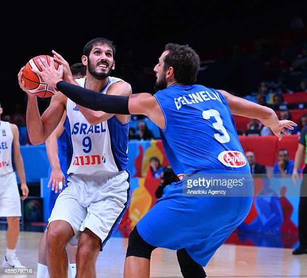 Israel's Omri Casspi vies against Italy's Marco Belinelli during the EuroBasket 2015 Round of 16 match between Israel and Italy at the Pierre Mauroy...
