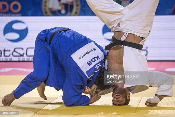 Israel's Or Sasson competes with South Korea's Kim SungMin during the men's qualification match in the 100kg category at the Judo World Championships...
