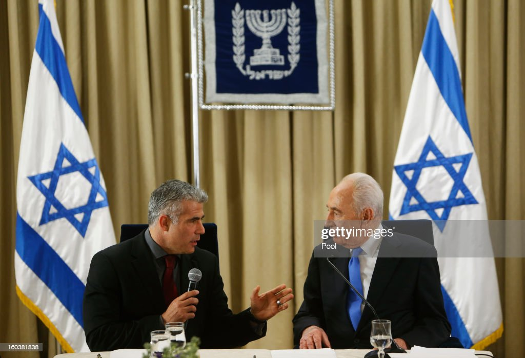 Israel's President Shimon Peres (R) listens as <a gi-track='captionPersonalityLinkClicked' href=/galleries/search?phrase=Yair+Lapid&family=editorial&specificpeople=5366792 ng-click='$event.stopPropagation()'>Yair Lapid</a>, leader of the Yesh Atid (There's a Future) party, speaks during their meeting on January 30, 2013 in Jerusalem, Israel. President Shimon Peres today formally began a period of consultation with the various parties to select the MP most able to put together the country's next ruling coalition, with incumbent Prime Minister Benjamin Netanyahu the favourite to assemble the coalition.