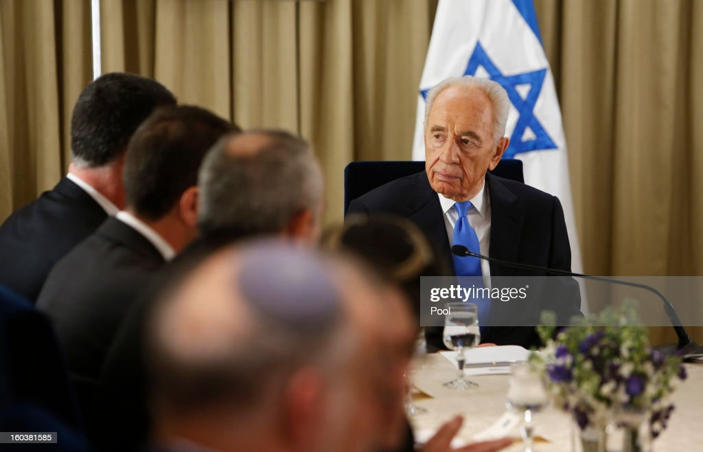 Israel's President <a gi-track='captionPersonalityLinkClicked' href=/galleries/search?phrase=Shimon+Peres&family=editorial&specificpeople=201775 ng-click='$event.stopPropagation()'>Shimon Peres</a> meets with representatives of Israeli Prime Minister Benjamin Netanyahu's Likud-Beitenu party on January 30, 2013 in Jerusalem, Israel. President <a gi-track='captionPersonalityLinkClicked' href=/galleries/search?phrase=Shimon+Peres&family=editorial&specificpeople=201775 ng-click='$event.stopPropagation()'>Shimon Peres</a> today formally began a period of consultation with the various parties to select the MP most able to put together the country's next ruling coalition, with incumbent Prime Minister Benjamin Netanyahu the favourite to assemble the coalition.
