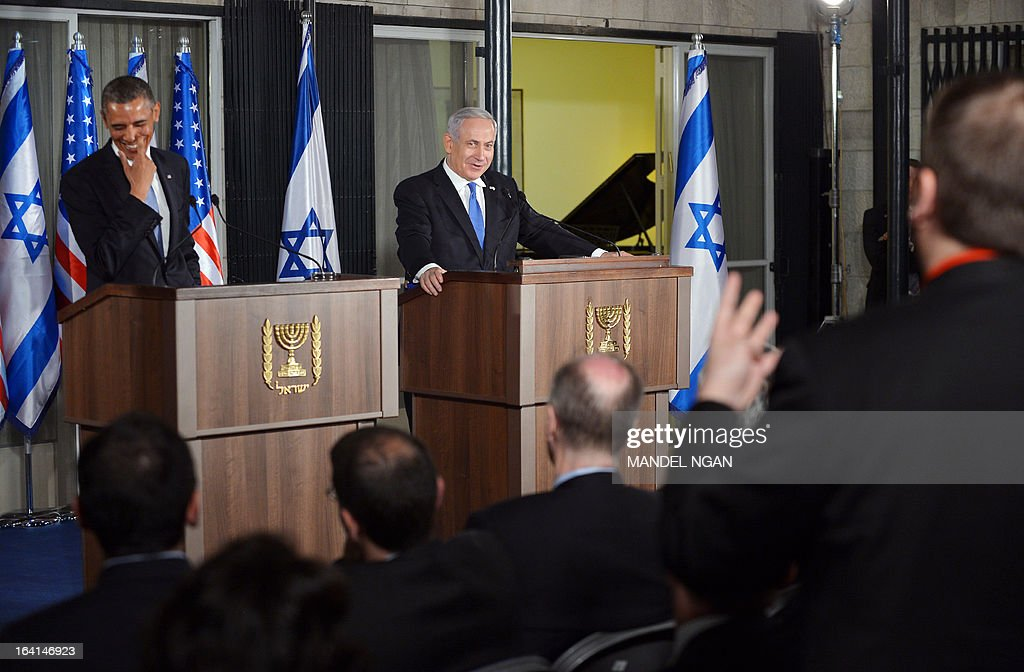 Israel's Prime Minister Benjamin Netanyahu (C) and US President Barack Obama react to a question from NBC's Chuck Todd during a joint press conference following a bilateral meeting at the Prime Minister's residence in Jerusalem on March 20, 2013. Obama landed in Israel for the first time as US president, on a mission to ease past tensions with his hosts and hoping to paper over differences on handling Iran's nuclear threat.