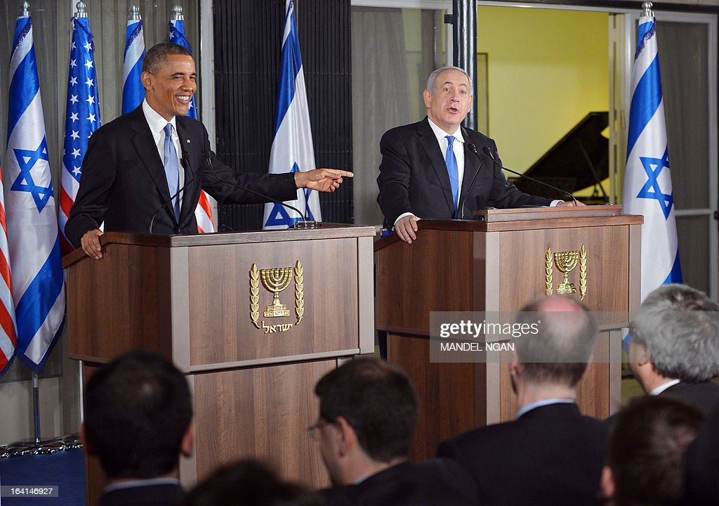 Israel's Prime Minister Benjamin Netanyahu (C) and US President Barack Obama react to a question from the press during a joint press conference following a bilateral meeting at the Prime Minister's residence in Jerusalem on March 20, 2013. Obama landed in Israel for the first time as US president, on a mission to ease past tensions with his hosts and hoping to paper over differences on handling Iran's nuclear threat.