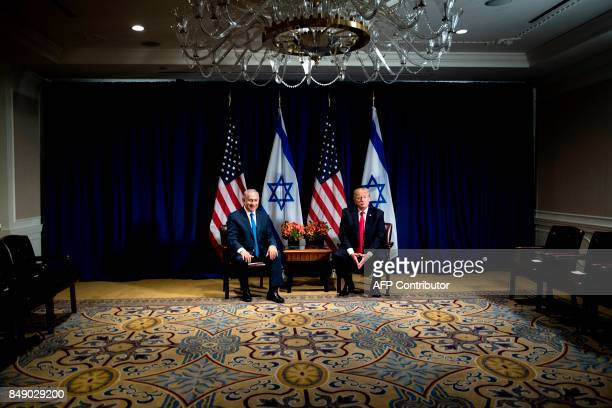 TOPSHOT Israel's Prime Minister Benjamin Netanyahu and US President Donald Trump wait for a meeting at the Palace Hotel during the 72nd session of...