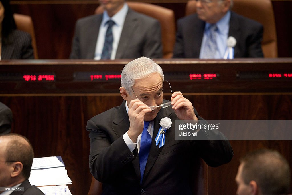 Israel's Prime Minister <a gi-track='captionPersonalityLinkClicked' href=/galleries/search?phrase=Benjamin+Netanyahu&family=editorial&specificpeople=118594 ng-click='$event.stopPropagation()'>Benjamin Netanyahu</a> attends the swearing-in ceremony of the 19th Knesset, the new Israeli parliament, on February 5, 2013 in Jerusalem, Israel. The 120 members included a record 48 new law makers.