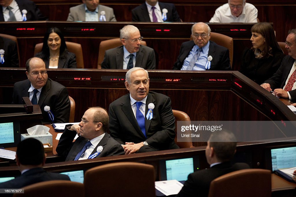 Israel's Prime Minister <a gi-track='captionPersonalityLinkClicked' href=/galleries/search?phrase=Benjamin+Netanyahu&family=editorial&specificpeople=118594 ng-click='$event.stopPropagation()'>Benjamin Netanyahu</a> (C) attends the swearing-in ceremony of the 19th Knesset, the new Israeli parliament, on February 5, 2013 in Jerusalem, Israel. The 120 members included a record 48 new law makers.