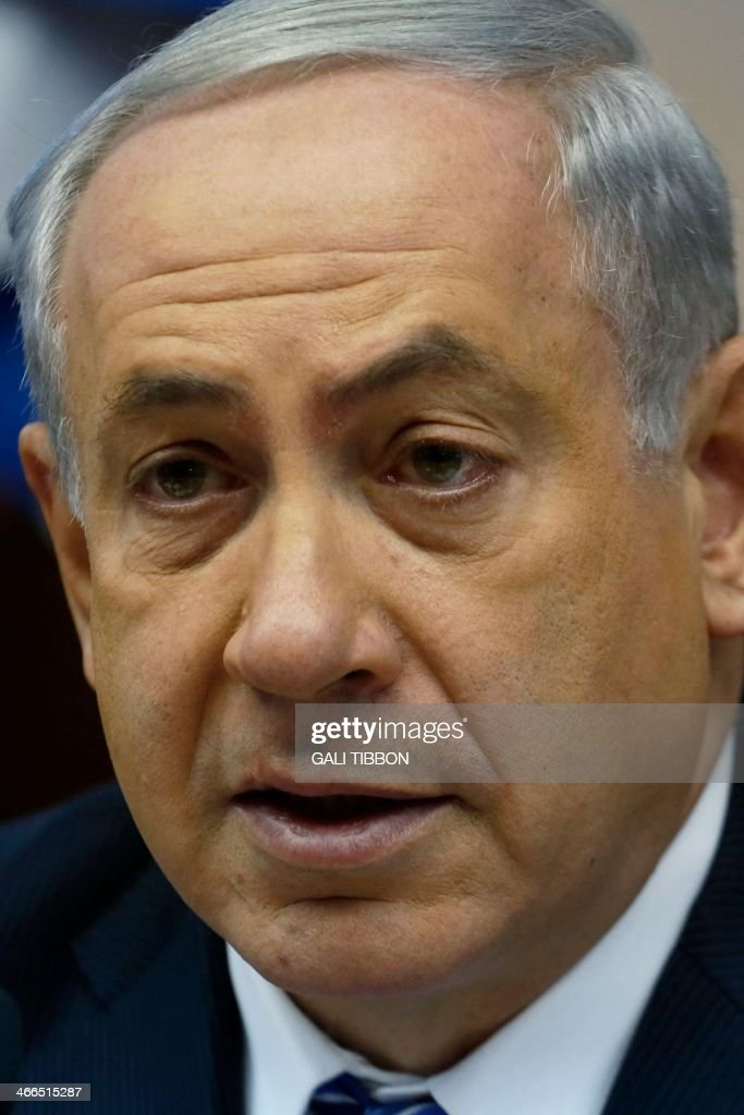 Israel's Prime Minister Benjamin Netanyahu chairs the weekly cabinet meeting in Jerusalem on February 2, 2014. Israeli Finance Minister Yair Lapid has decided to suspend the transfer of public funds to West Bank settlements pending a probe into their alleged misuse, his office said.