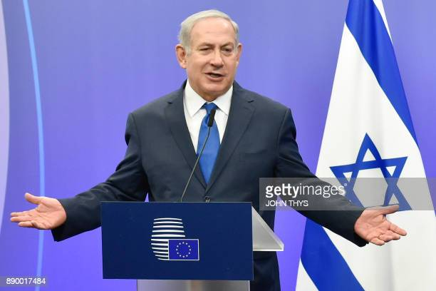 Israel's Prime Minister Benjamin Netanyahu gestures as he speaks during a joint press conference with the EU foreign policy chief at the European...
