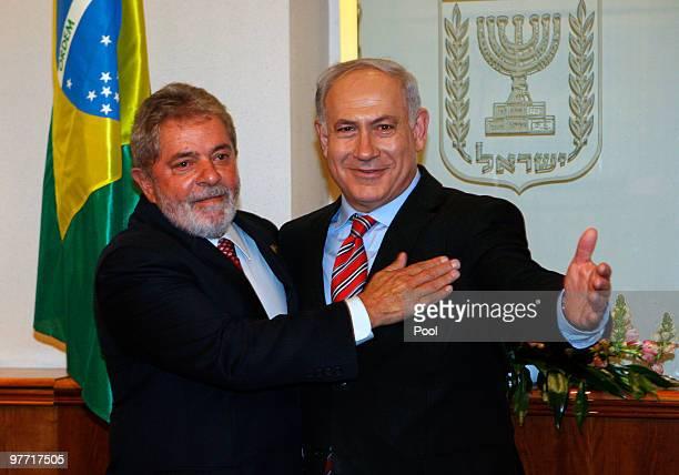Israel's Prime Minister Benjamin Netanyahu greets Brazilian President Luiz Inacio Lula da Silva before their meeting on March 15 2009 in Jerusalem...
