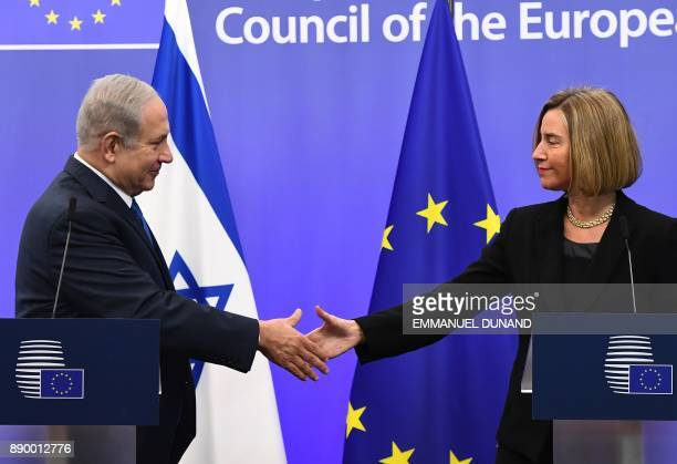 Israel's Prime Minister Benjamin Netanyahu is welcomed by EU foreign policy chief Federica Mogherini at the European Council in Brussels on December...