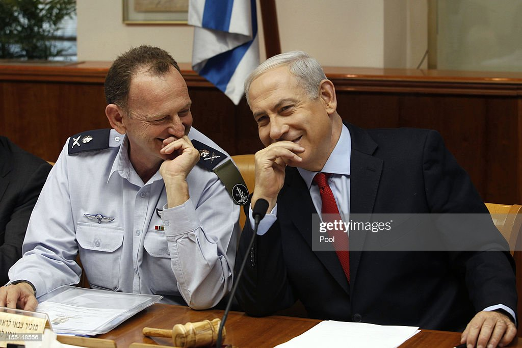 Israel's Prime Minister Benjamin Netanyahu laughs with his military secretary, Major General Yohanan Locker during a weekly cabinet meeting on November 4, 2012 in Jerusalem, Israel. Netanyahu's government received criticism this weekend from Defense Minister Ehud Barak, who believes that the government should have done more to advance the middle east peace process.