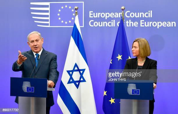 Israel's Prime Minister Benjamin Netanyahu speaks as EU foreign policy chief Federica Mogherini looks on during a press conference at the European...