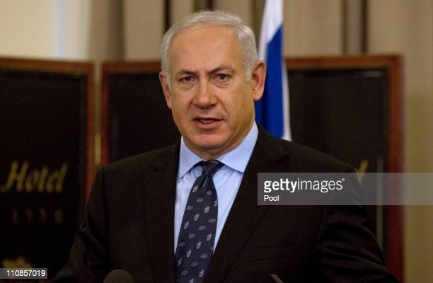 Israel's Prime Minister Benjamin Netanyahu speaks during a joint press conference with visiting US Defence Secretary Robert Gates following a meeting...