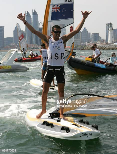 Israel's Shahar Zubari celebrates winning Bronze in the final round of the Men's RSX Sailing Competition at the Olympic Games' Sailing Centre in...